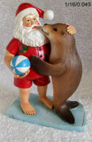 Beautiful Christmas ornament - Santa with a Seal at the Beach. 140mm x 90 mm x 185mm