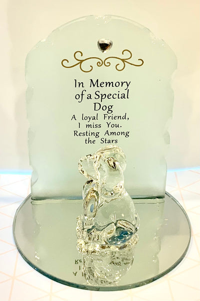 Beautiful memorial made from glass. Each piece is set on a mirrored circles with a lovely frosted glass backing with a a small heart  jewel and gold embossment. A glass cat or dog figurine sits in front of the memorial piece.  Saying:   Dog: In Memory of a Special Dog A loyal friend, I miss you, resting amount the stars.