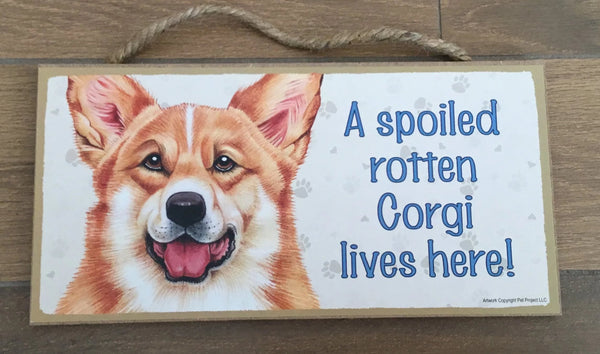 Sign with an image: A spoiled rotten Corgi lives here!