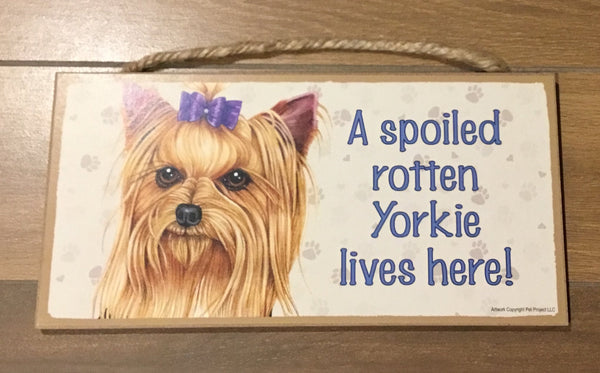 Sign and image - A spoiled rotten Yorkie lives here!