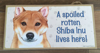 Sign and image - A spoiled rotten Shiba Inu lives here!