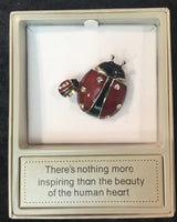 Ladybird brooch red and black with saying - There's nothing more inspiring than the beauty of the human heart.