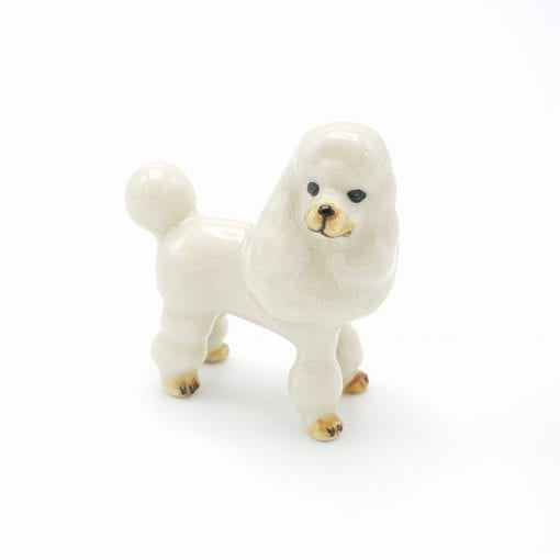 Standing White poodle figurine - A pretty white poodle with gray markings that is part of our extensive dog range.  As our ceramic animals are handcrafted and handpainted, size, colour and markings may vary.  This ceramic collectable figurine measures approx :  Sitting 6cm x 3.2cm x 6.1cm H  Made in Thailand.