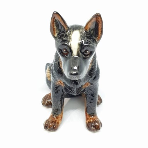 Cattle Dog Sitting, black/grey. Everyone loves a cattle dog, an Australian icon. There are 3 styles available.  As our Ceramic is hand blown and crafted, size, colour and markings may vary.  This figurine measures approx 5.3cm x 10cm x 9.5cm high.  Made in Thailand.
