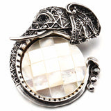 Elephant Brooch with inlay of mother's of Pearl under its trunk