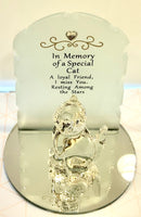 Beautiful memorial made from glass. Each piece is set on a mirrored circles with a lovely frosted glass backing with a a small heart  jewel and gold embossment. A glass cat or dog figurine sits in front of the memorial piece.  Saying:   Cat: In Memory of a Special Cat A loyal friend, I miss you, resting amount the stars.