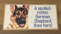 Sign and Image: A spoiled rotten German Shepherd lives here!