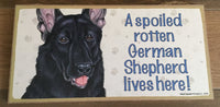 Sign and Image: A spoiled rotten German Shepherd lives here! (black in Colour)