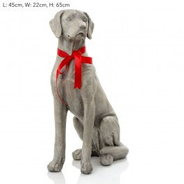 Sitting Puppy with Red Bow