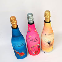 photo of 3 different Champagne Bottle Covers - Magnificient (out of stock), Bubbles and Be Effervescent.
