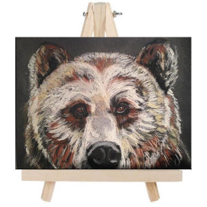 fine art beautiful big brown bear on easel