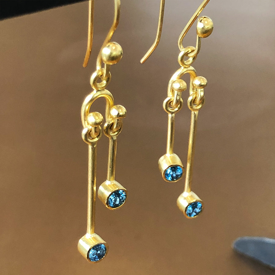 The Philippe Spencer London Blue Topaz Earrings Wrapped in 22K Gold