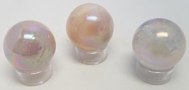 Polished Angel Aura Rose Quartz Sphere