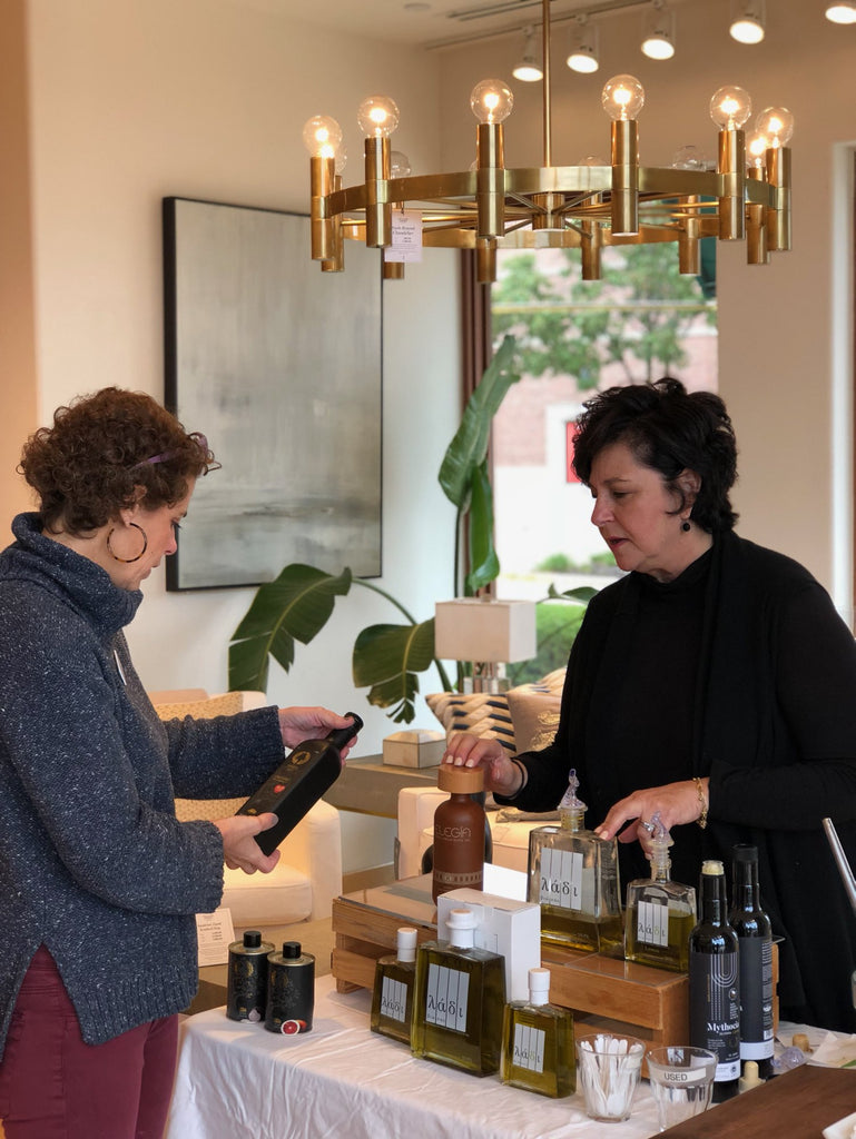 Kathy sampling Olive Oil at Williams-Sonoma in Leawood, KS!