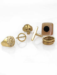 Brass and bone ring collection