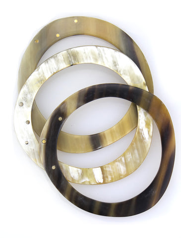 Set of 3 bone and brass bangles