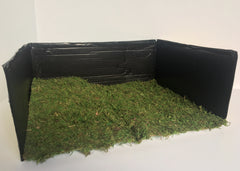 DIY Graveyard: Place moss in cardboard box