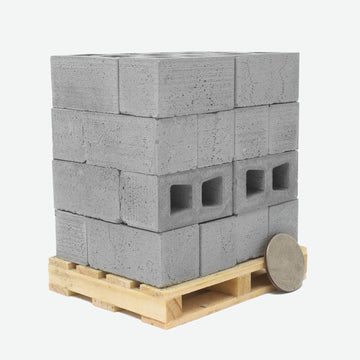 24 of the 1:10 Scale Miniature Cinder Blocks on wooden pallet with a quarter propped up on the front right side to show scale.