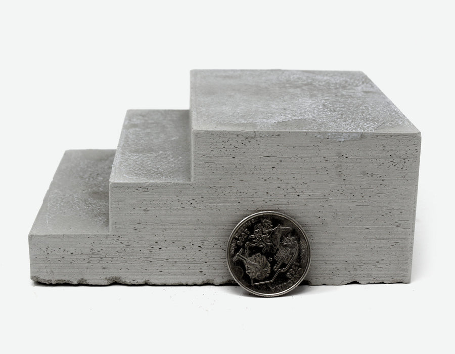 1:12 Scale miniature concrete steps with a quarter to scale, limited stock item.