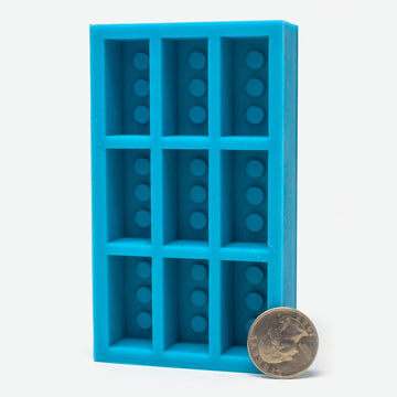 A 9 piece 1:6 scale mini red brick mold with quarter for scale.