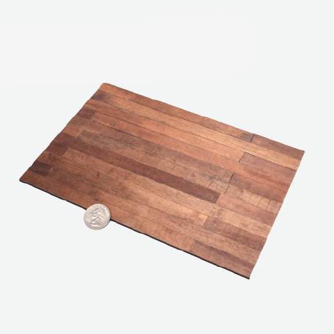 1:12 scale faux wood laminate with a quarter sitting to the left to show scale.