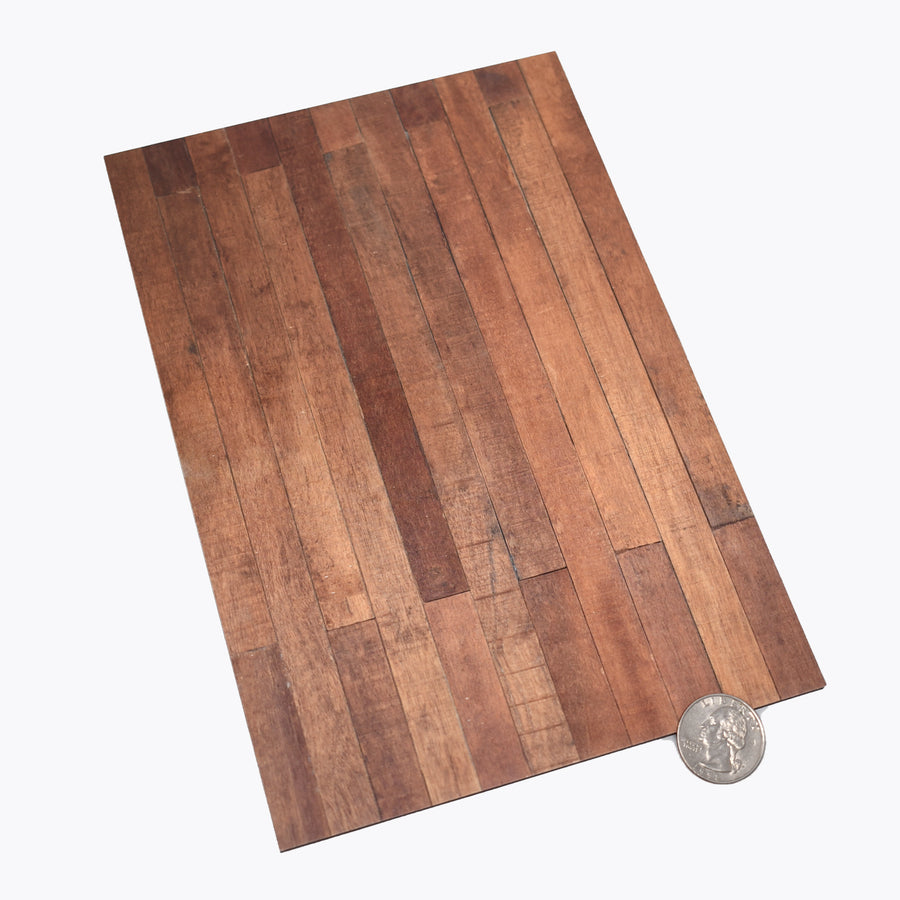 1:12 scale faux wood laminate with a quarter sitting at the bottom right corner to show scale.
