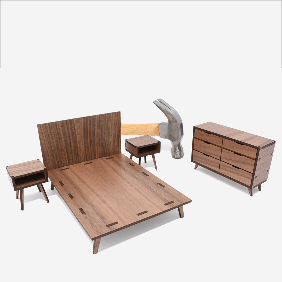 1:12 scale midcentury scale collection bedroom set with nightstands, a queen size bed, and a dresser. there is a hammer behind the set.