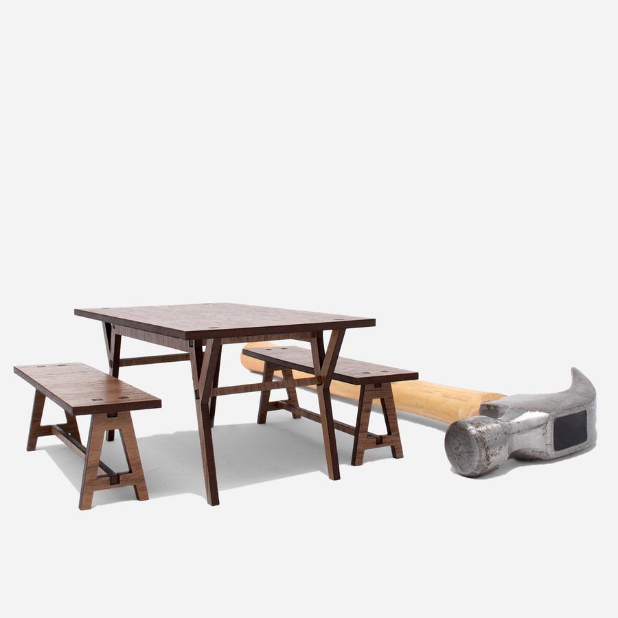 a midcentury modern dining room table and benches. 1:12 scale . there is a hammer behind the dining table and benches to show scale.