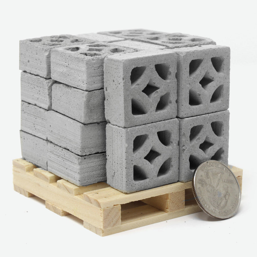 24 cement empress style breeze blocks on a miniature pallet with a quarter for scale.