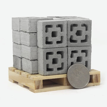 24 Vista vue mini breeze blocks on a small pine pallet with a quarter against it for scale.