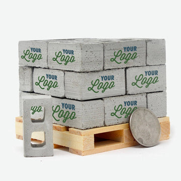 A pine pallet containing 24 1:12 scale mini cinder blocks with a quarter leaning against them. Each block has