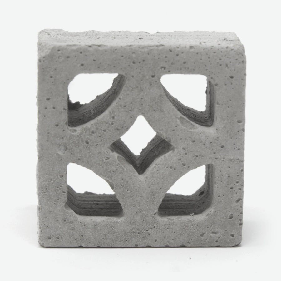 A close up of a single mini empress style breeze block.