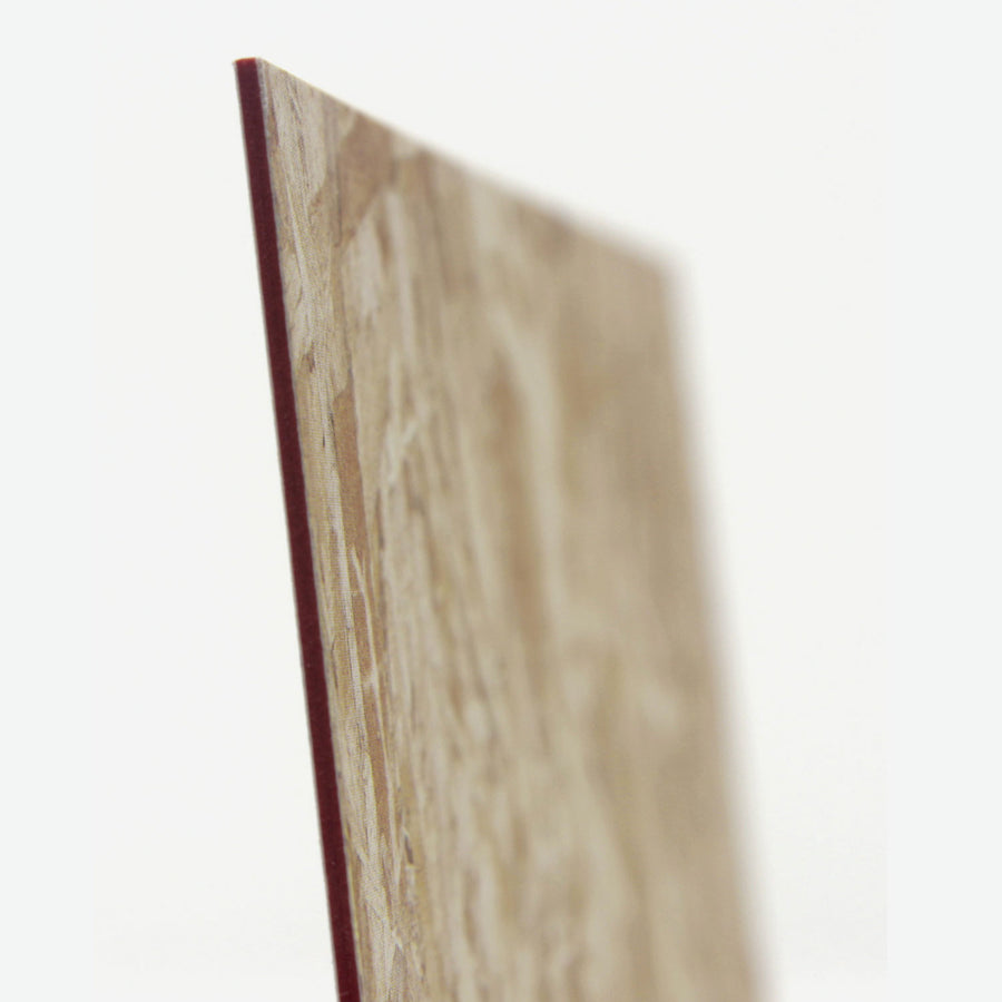 The side profile of the miniature plywood with red edges.