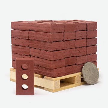 1:6 scale mini red bricks on wooden pallet with quarter for scale