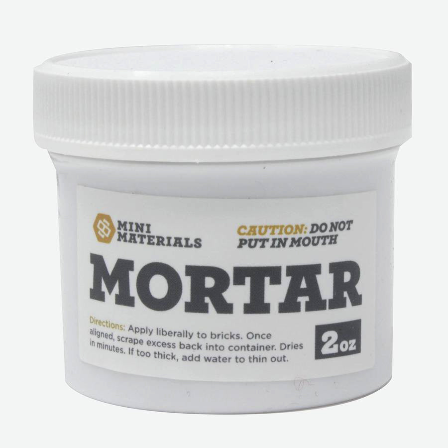 White container with 2oz of mortar. White decal with the words