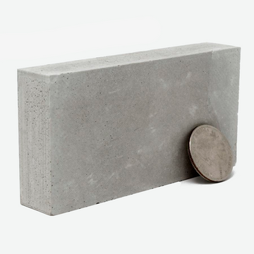 1:12 Scale miniature concrete slab with a quarter to scale, limited stock item.
