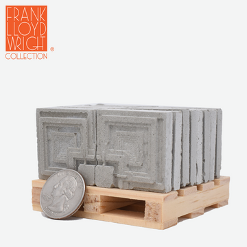 1:12 scale mini concrete textile blocks that mimic the frank lloyd wright ennis house textile blocks on a mini wood pallet with a quarter sitting in front to show scale.