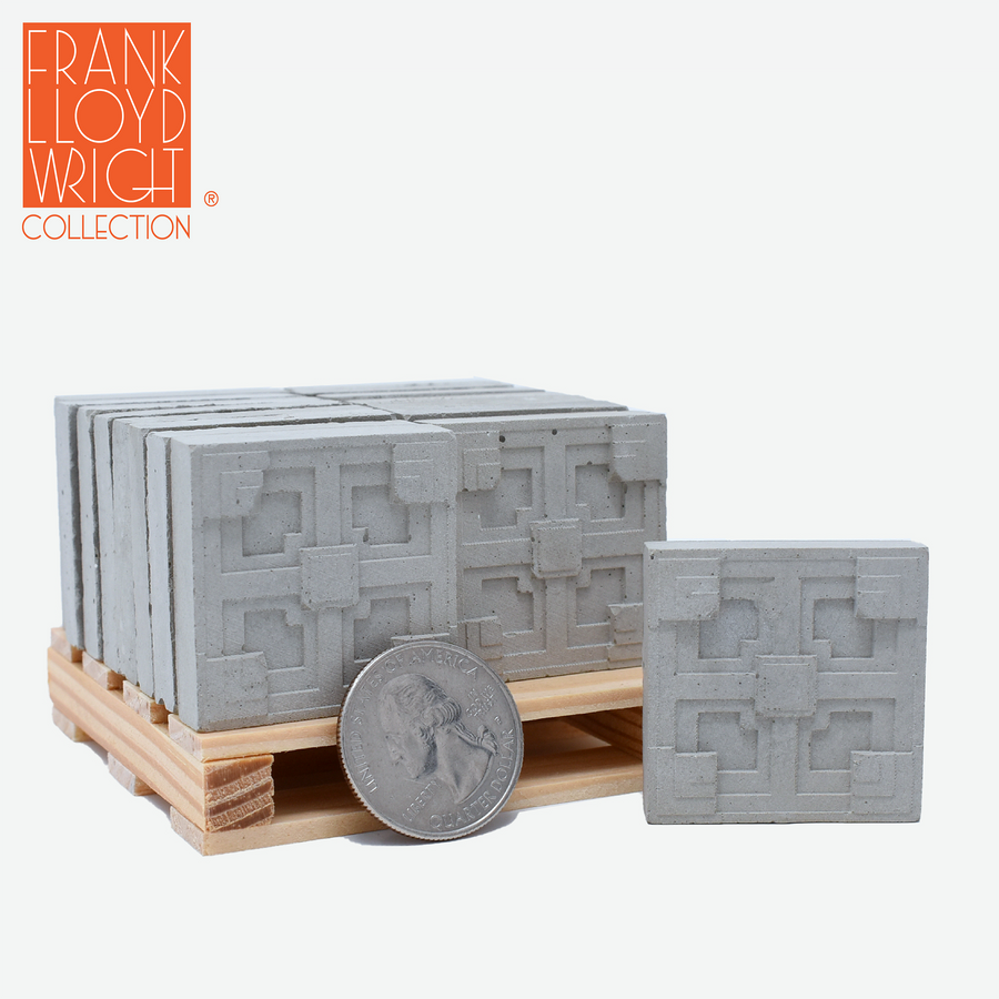 1:12 scale mini concrete textile blocks that mimic the frank lloyd wright storer house textile blocks on a mini wood pallet with a quarter sitting in front to show scale.