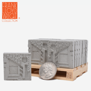 1:12 scale mini concrete textile blocks that mimic the frank lloyd wright freeman house textile blocks on a mini wood pallet with a quarter sitting in front to show scale.