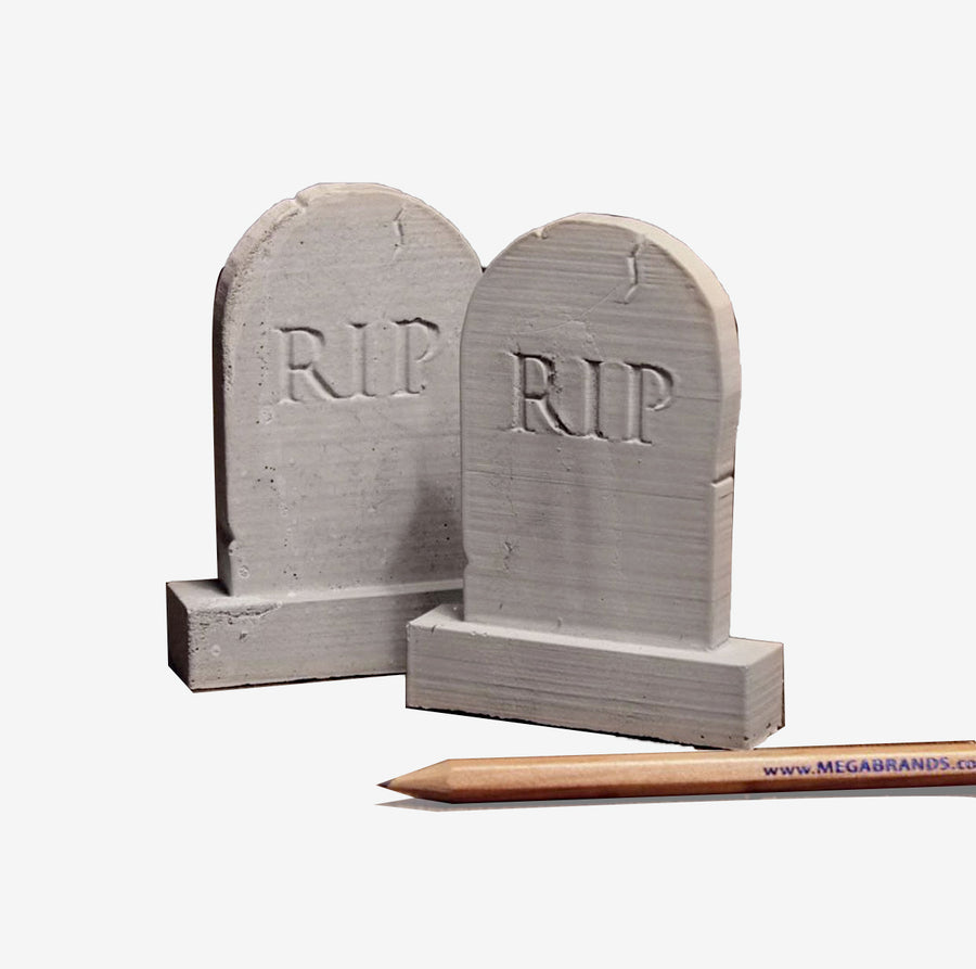 1:12 scale miniature tombstones with Rest In Peace (RIP) engraved, hand for scale, limited stock item.