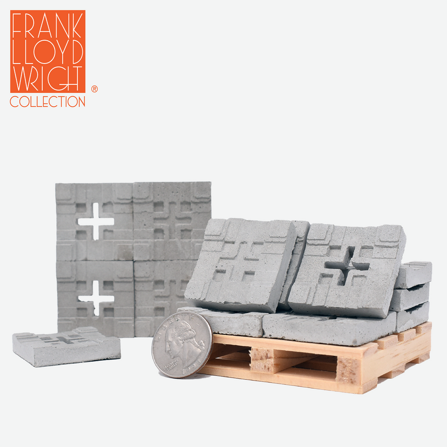 1:12 scale mini concrete textile blocks that mimic the frank lloyd wright millard house textile blocks. some are sitting on a mini wood pallet and have a quarter sitting in front to show scale.. there are 4 mini textile blocks stacked up like a wall.