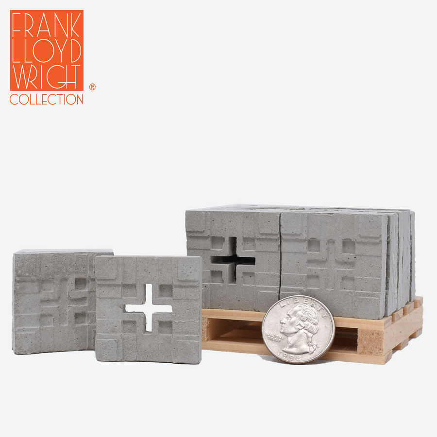 1:12 scale mini concrete textile blocks that mimic the frank lloyd wright millard house textile blocks on a mini wood pallet with a quarter sitting in front to show scale. Two of the blocks are sitting on the ground to the left of the pallet.
