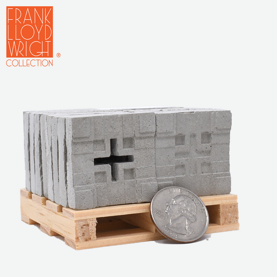 1:12 scale mini concrete textile blocks that mimic the frank lloyd wright millard house textile blocks on a mini wood pallet with a quarter sitting in front to show scale.