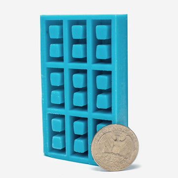 1:18 scale miniature torquise silicone mold for cinder blocks with a quarter for scale