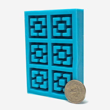 1:12 scale miniature torquise silicone mold for vista view style breeze blocks with a quarter for scale