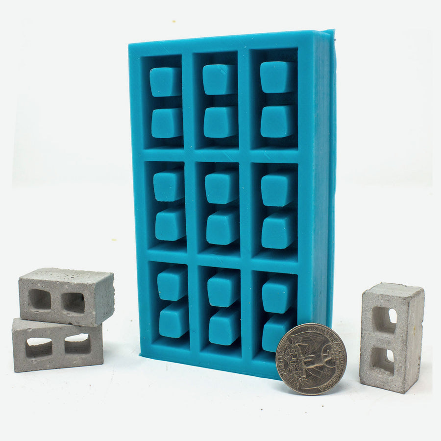 A 9 piece 1:12 scale mini cinder block mold with quarter for scale.