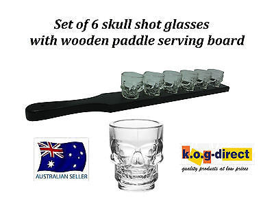 SET OF 6 SKULL SHOT GLASSES WITH BLACK WOODEN PADDLE SERVING TRAY