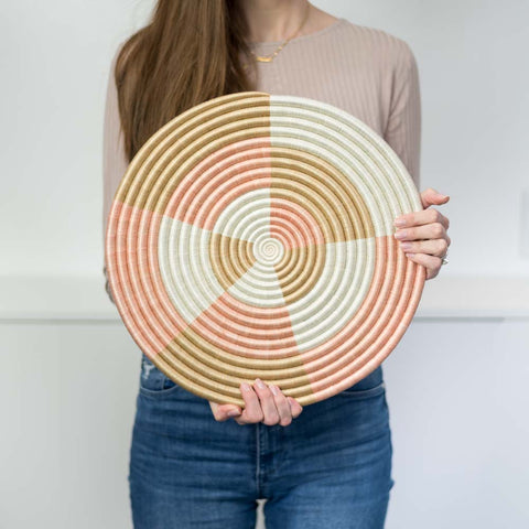 "Model holding the 14"" Staccato flat circle"