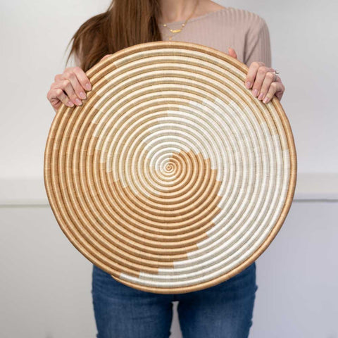"Model holding the Zera 18"" flat circle"