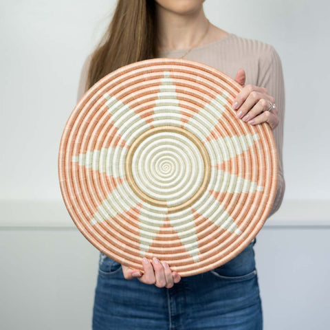 Model holding the Zuba flat circle.